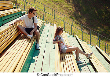 Modern urban young couple in the park, youth, love, dating, stud