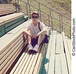 Vintage photo modern hipster man resting on the bench in the...