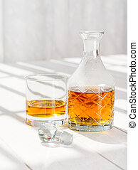 Whisky decanter and rocks glass - Photo of a whisky decanter...