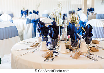 Wedding - Banquet hall decorated for wedding in white and...