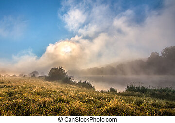 Foggy morning on the river - clouds skyes and grass...