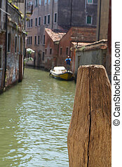Venetian canal and wooden berth