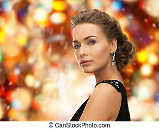 beautiful woman in evening dress wearing earrings - people,...