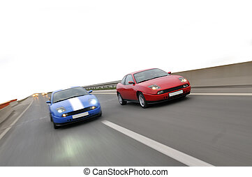 Isolated tuning cars racing on highway - Picture of solated...