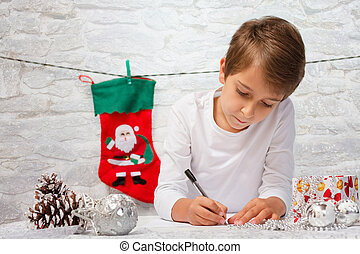 Boy writes a letter to Santa Claus