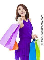 asian smiling young woman holding shopping bag over white...