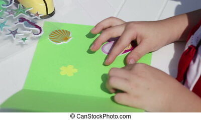 Employment applique - Child enthusiastically engaged...