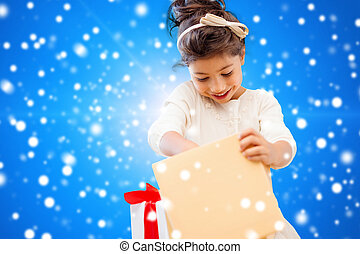 smiling little girl with gift box - holidays, presents,...