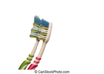Green and red tooth brushes isolated on the white background