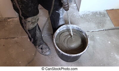man mix tile cement