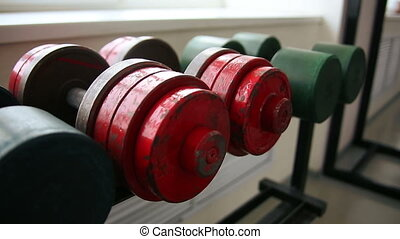 Dumbbells on the shelf