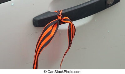The St George ribbon on the handle of the car