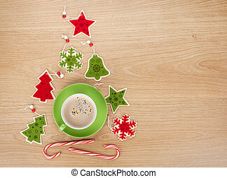 Christmas decor and coffee cup over wooden table background...