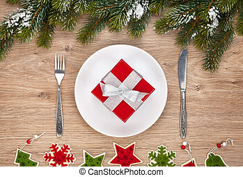 Gift box on plate and silverware - Gift box on plate, fir...