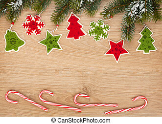 Christmas fir tree, candy cane and decor on wooden board...