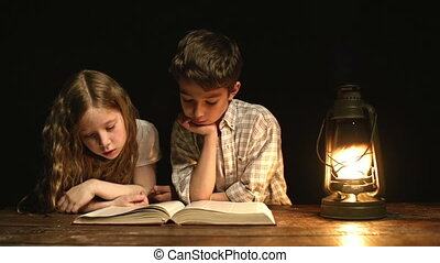 Siblings Reading a Book - Close up of two kids sitting in...