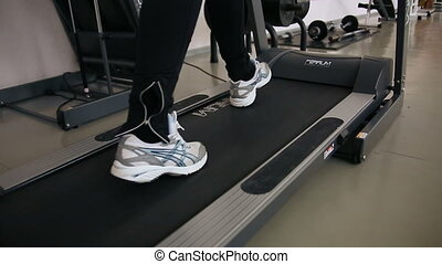 Feet on running , the simulator - Legs on a treadmill, cross...