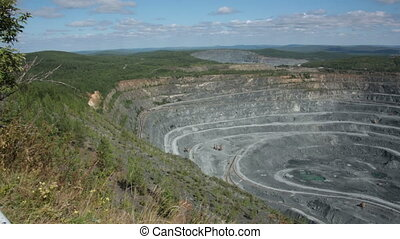 Quarry for mining of ore, minerals. Dust after the...