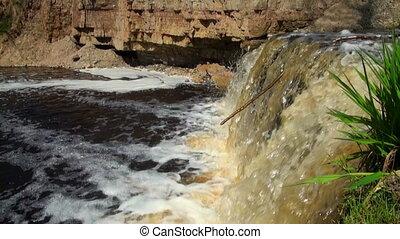 Waterfall in rocky shore