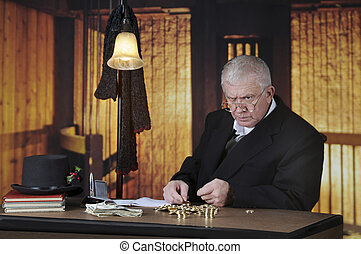 Coin Counting Miser - A grumpy old miser sitting at his desk...