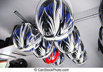 Go-Kart helmets hanging assorted. Karting circuit workshop
