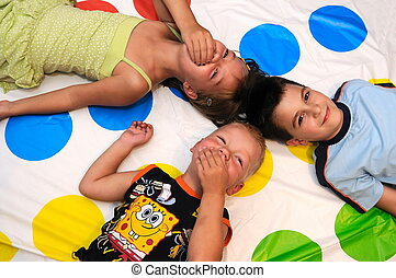Happy three kids playing together and smiling
