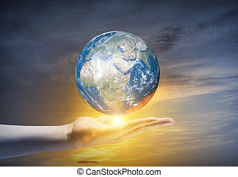 Our Earth planet - Human hand holding Earth planet Elements...