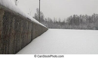 The snow on the asphalt to the curb