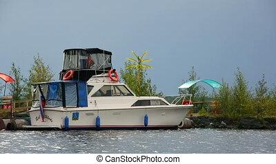 The boat at a mooring on lake