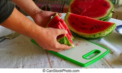 Watermelon - Man cuts the watermelon into slices