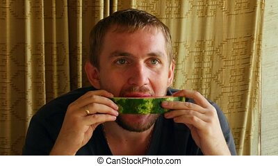 Watermelon - Young man eating tasty, juicy watermelon