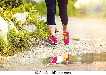 Senior woman running closeup feet - Senior runner woman feet...