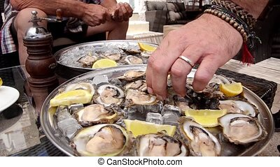 oysters delicacies on a silver plate