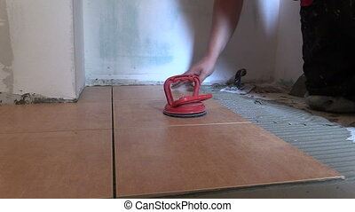 worker place tiles - worker man place floor tiles Home...