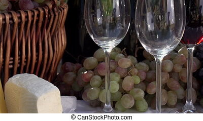 Wine Festival - In pouring a glass of wine on the background...