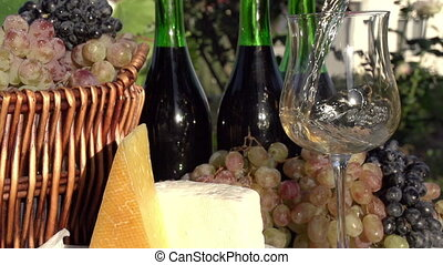White Wine is Poured from a Bottle - In pouring a glass of...