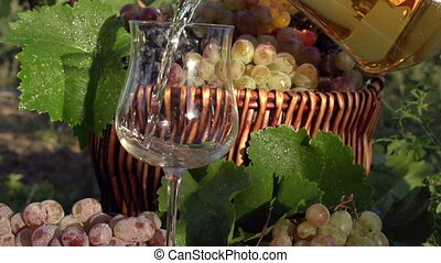 Pouring Grape Juice - Grape juice is poured from a jug into...