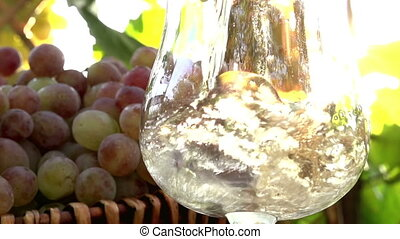 Champagne Wine in the Sun - Sparkling Wine is poured into a...