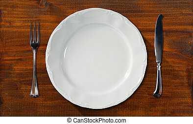 Empty Plate on Wooden Table with Cutlery - Empty and white...