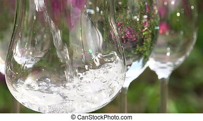 Filling a Glass of Clean Water - Sparkling mineral water is...