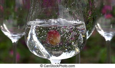 Grapes Fall into a Glass