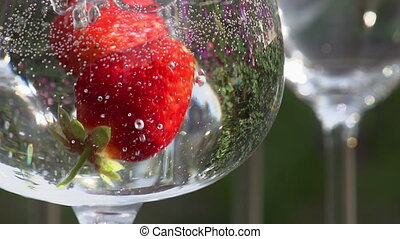Strawberries Falling into a Glass