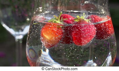 Strawberry Rotates in a Glass with