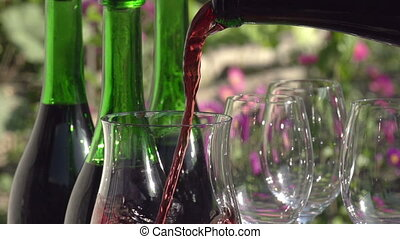 Filling a Glass of Wine - Red wine pouring down from a...