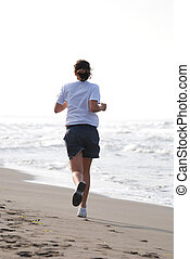 woman jogging outdoor on beach