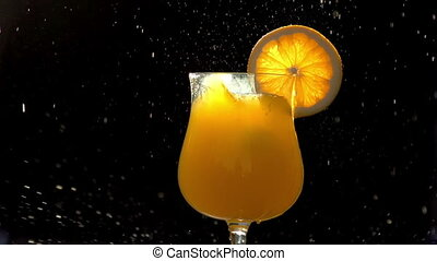 Ice Cubes in Orange Juice - Ice cubes falling into a glass...