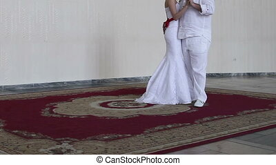 bride dancing with her fiance and he slaps her on the ass