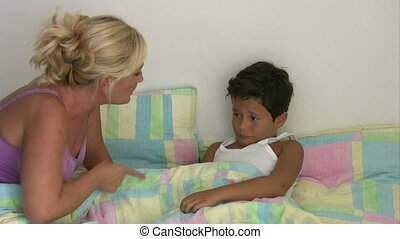 Angry mother scolding her son - Angry mother scolding his...
