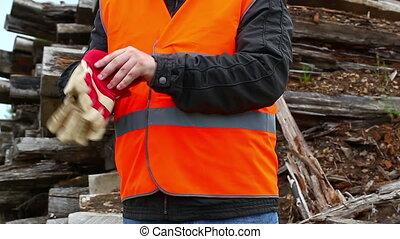 Worker donning work gloves