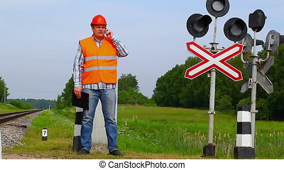 Railroad worker with cell phone 2